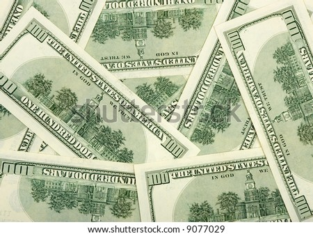 Reverse sides of dollars - business background - stock photo