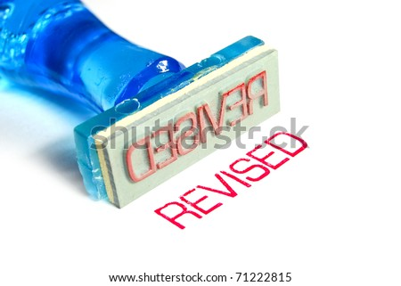 revised letter on blue rubber stamp isolated on white background - stock photo