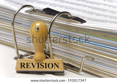 revision marked on rubber stamp - stock photo