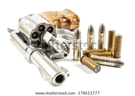 revolver and bullets on white background (isolated) - stock photo