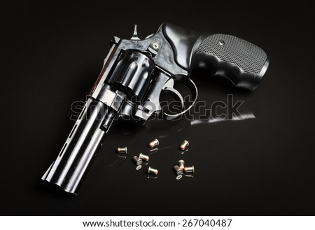 Revolver gun on black background - stock photo