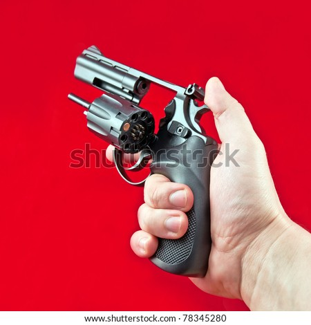 revolver in the man's hand, russian roulette - stock photo