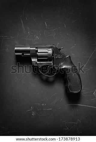 Revolver pistol / studio photography of handgun on black background  - stock photo