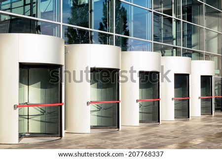 revolving doors at an office building - stock photo