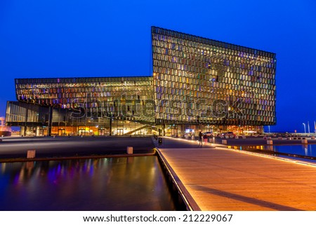 REYKJAVIK, ICELAND - AUGUST 31, 2013: Harpa concert hall in Reykjavik, Iceland. Harpa was opened on May 13, 2011. It was selected as Best Performance Venue 2011 by Travel & Leisure magazine - stock photo