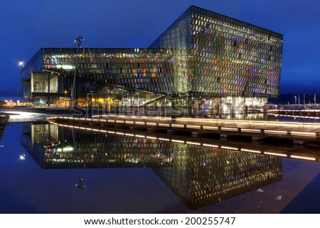 REYKJAVIK, ICELAND - AUGUST 9: Twilight scene of Harpa Concert Hall in Reykjavik harbor, Iceland late evening of August 9, 2013. The Harpa Concert Hall is the new landmark of the city, build in 2011. - stock photo