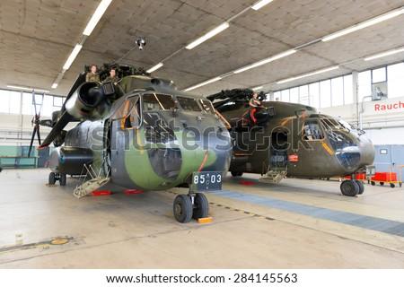 RHEINE-BENTLAGE, GERMANY JUL 01, 2011: German Air Force CH-53 transport helicopters in a hangar during the open house at Rheine-Bentlage Air Base. - stock photo