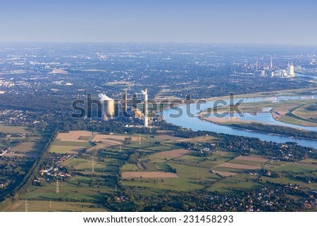 Rhine River bend Orsoy with agricultural, industrial and residential districts in the Lower Rhine Region of Germany - Voerde, North Rhine-Westfalia, Germany, Europe - stock photo