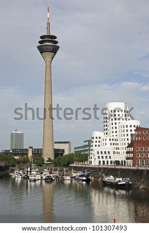 Rhine Tower & harbour scene - stock photo