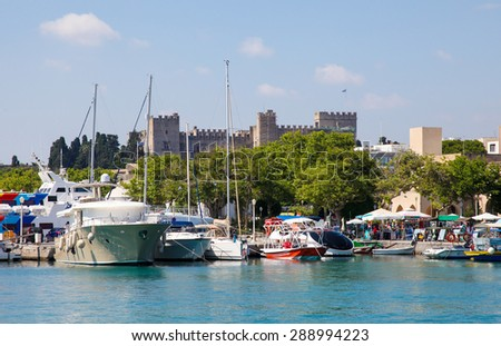 RHODES, GREECE - JUNE 12, 2015: Harbour and Palace of the Grand Master of the Knights of Rhodes, Greece. - stock photo