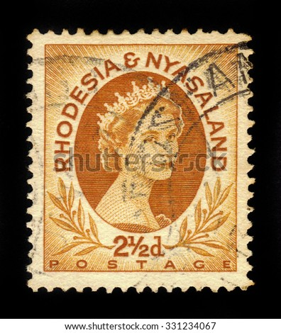 RHODESIA AND NYASALAND - CIRCA 1954: A stamp printed in Federation of Rhodesia and Nyasaland, also known as the Central African Federation (CAF) shows Queen Elizabeth II, circa 1954 - stock photo