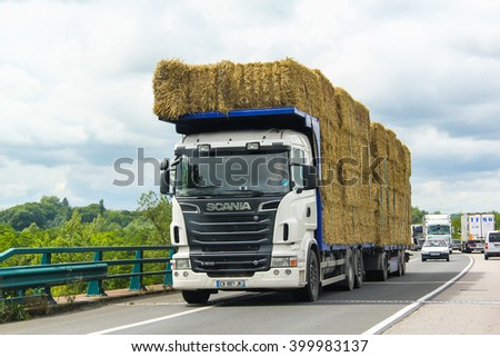 RHONE-ALPES, FRANCE - AUGUST 7, 2014: White hay carrier Scania R500 at the interurban freeway. - stock photo