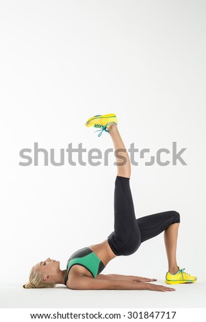 Rhythmic gymnast in a beautiful sportswear doing exercise in studio. - stock photo