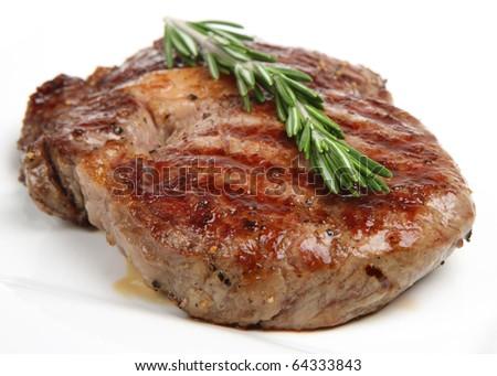 Rib-eye steak resting - stock photo