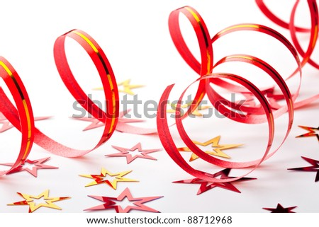 Ribbon and confetti on white background - stock photo