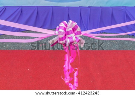 ribbon bow, ribbon cutting in ceremony.(select focus ribbon bow) - stock photo