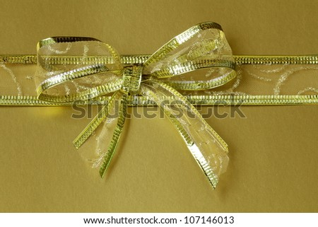 ribbon golden  tied bow for holiday background - stock photo