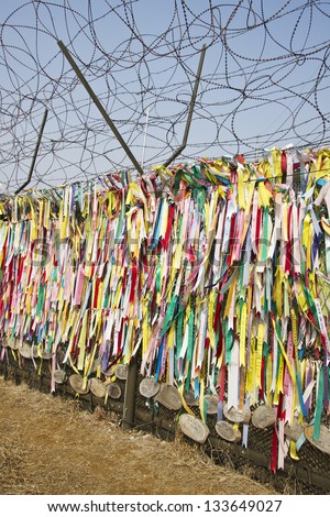 Ribbons left by visitors with hope for unification in Imjingak Park in Paju, South Korea near the DMZ. - stock photo