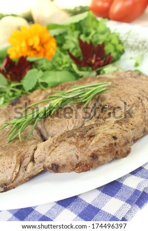 ribeye steak with wild herb salad and rosemary - stock photo