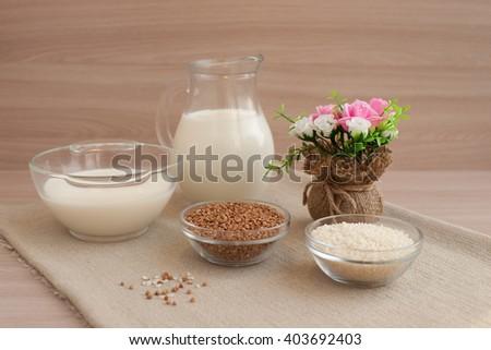 Rice and buckwheat groats on sacking - stock photo