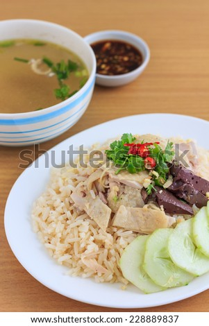 Rice and chicken steam with chicken soup (thai food) - stock photo