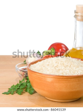 rice and food ingredient isolated on white background at wood table - stock photo