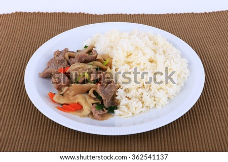 Rice and Fried beef with oyster sauce on white dish, isolated - stock photo