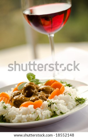 Rice and meatballs, red wine - delicious dinner - stock photo