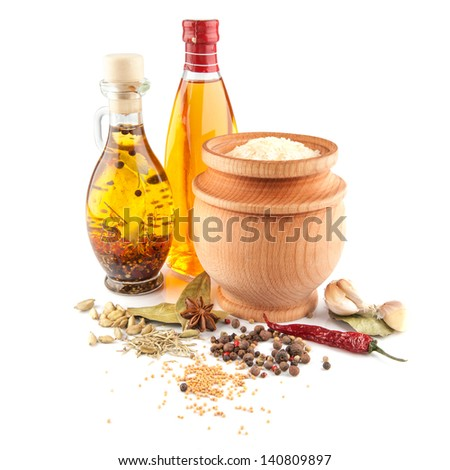 rice and olive oil with spices isolated on white - stock photo