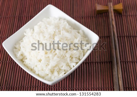 Rice - Bowl of steamed white rice and chopsticks. - stock photo