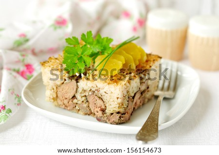 Rice, chicken liver and mushroom bake - stock photo