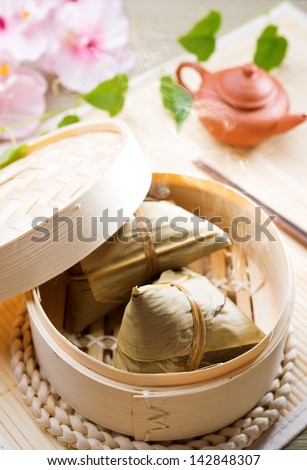 Rice dumpling or zongzi. Traditional steamed sticky  glutinous rice dumplings. Chinese food dim sum. Asian cuisine. - stock photo