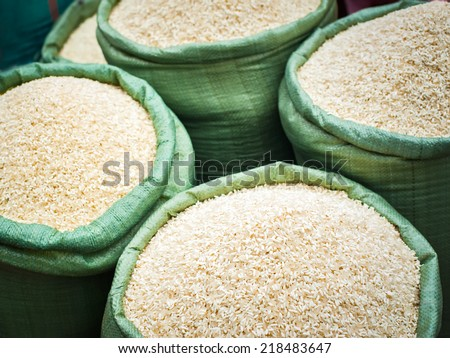 Rice for sale at the asian market. Organic food background - stock photo