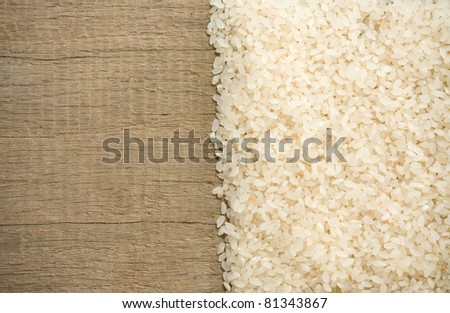 rice grain and wooden background texture - stock photo