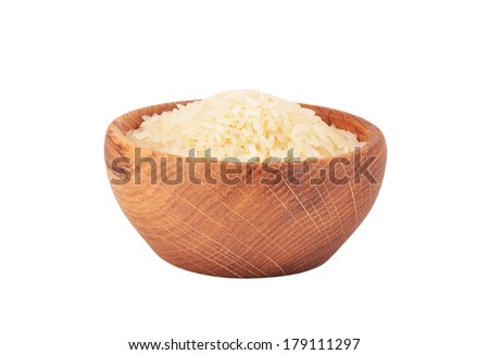 Rice in a wooden bowl, isolated on white background - stock photo