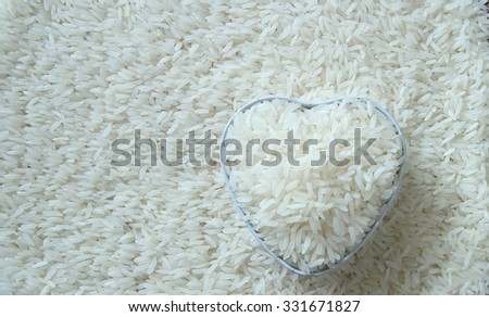 Rice in bowl on white rice background - stock photo