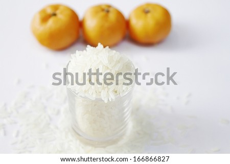 rice in glass bowl close up isolated on white background - stock photo