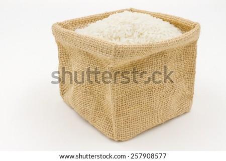 rice in small burlap sack - stock photo