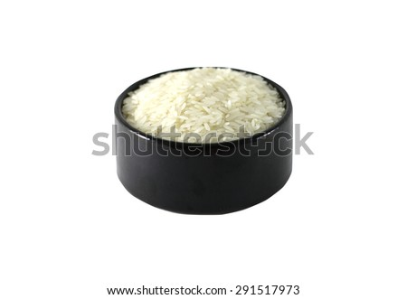 Rice in the bowl. Shallow dof.  - stock photo
