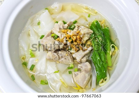 Rice noodle soup with chicken and canton leaf - stock photo
