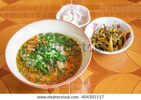 Rice noodles with soup is a noodle soup or curry of the cuisine of the Tai Yai people. Rice noodles has a characteristic spicy and tangy flavor. thai food. - stock photo