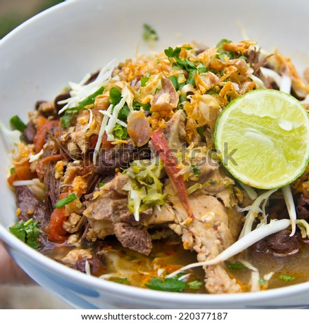 rice noodles with spicy pork sauce, one of a popular Northern Thai food . - stock photo