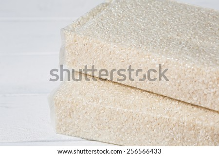 Rice oil and vacuum packed in plastic bags - stock photo