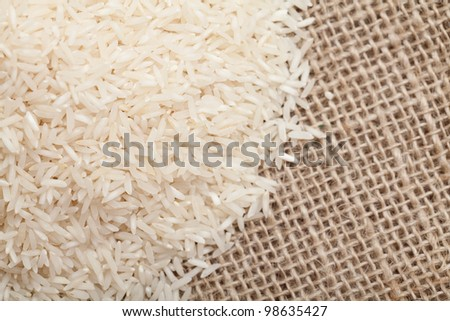 rice on sackcloth - stock photo