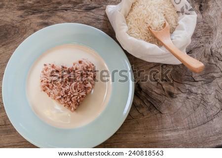 rice on wood background - stock photo