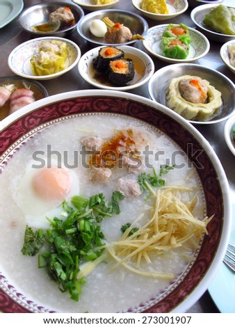 Rice porridge and various kind of Dimsum (Chinese-Thai steamed food) for breakfast - stock photo