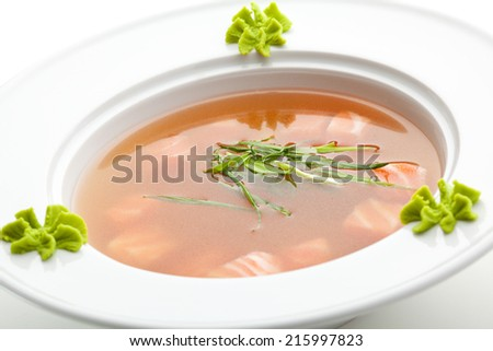 Rice Soup with Salmon. Garnished with Leek and Wasabi - stock photo