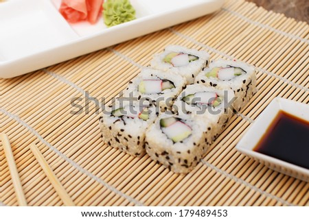 Rice sushi with seeds and soy sauce - stock photo