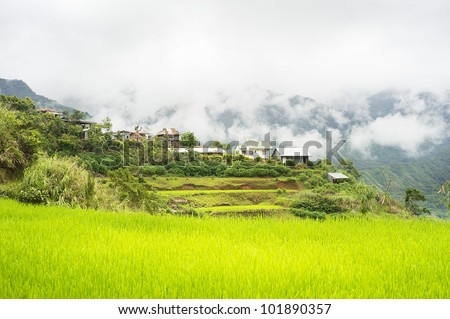 Rice terrace and village in Cordillera mountains, Philippines - stock photo