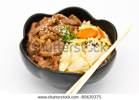 rice under fried pork and vegetable on white background - stock photo